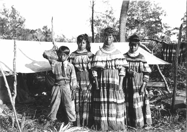 Photo of four members of a Seminole Family